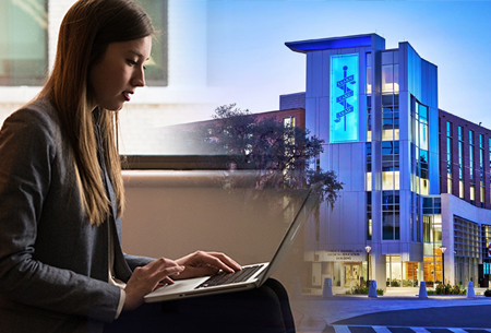 Woman on laptop with Harrell Building composite